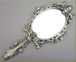 Miroir face main style louis xvi bronze argent for Dormir face a un miroir